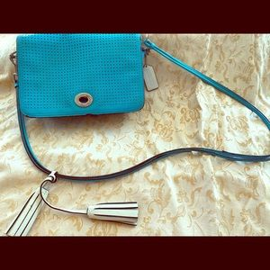 Coach crossbody, perforated blue with white tasel